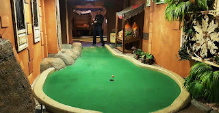 About to ace hole 2 of the Tiki Hut Trail at Paradise Island Adventure Golf in Manchester