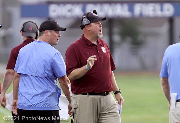 SJO head coach Shawn Skinner yells instructions
