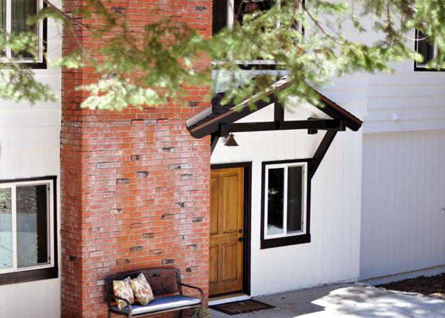 white house black trim brick and brown