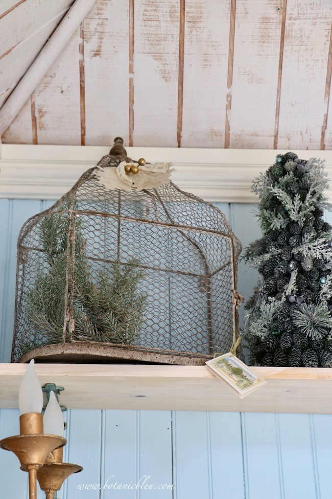 French Country Christmas Event 2019 has wire bird cages and small faux trees