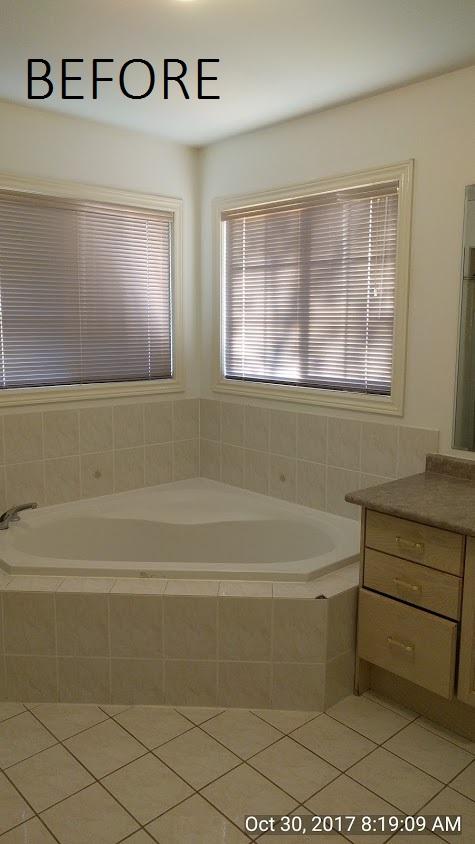 before pic of tub in builders grade washroom