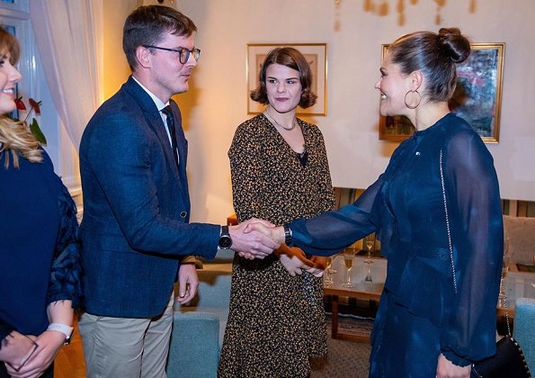 Crown Princess Victoria wore StarStudio PR Baroque pearl earrings, a new printed dress by Rodebjer. HM Dark blue dress