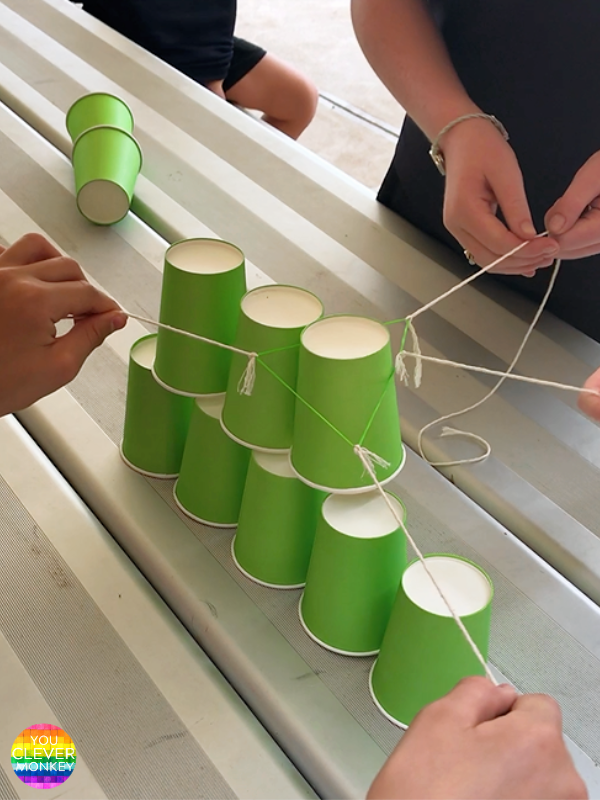 CHRISTMAS TREE STEM CUP STACKING CHALLENGE FOR CLASS - Recreate this Christmas STEM challenge in your classroom this festive holiday season with materials you might already have at school! #stemactivities #christmasstemactivities #christmasactivitiesforfirstgrade #christmasactvitiesforsecondgrade