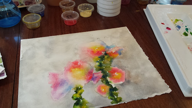 Hollyhocks in watercolor on watercolor paper.