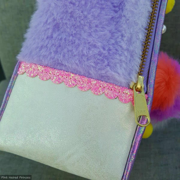 side of handbag with ivory metallic, lilac fur and pink glitter trim