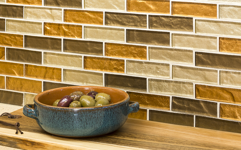 Glass tile works great for kitchen backsplashes.