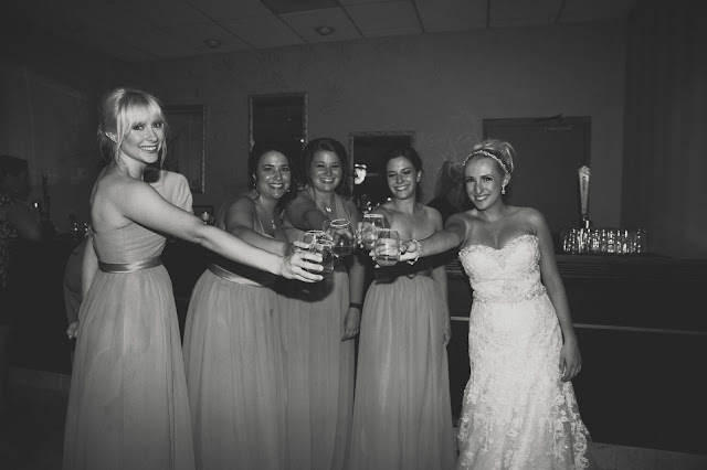 bride and bridesmaids doing a shot at reception at Fern Hill Golf Course