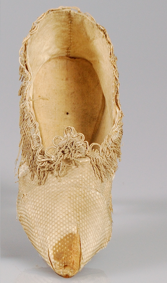 Shoes that belonged to Marie Antoinette with fringe along the top