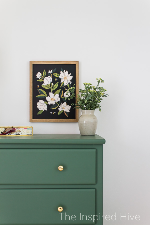 Magnolia framed print on green painted dresser with brass hardware