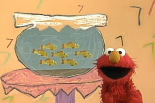 Seven goldfish in an aquarium and Elmo sing the song Seven Goldfish. Sesame Street 123 Count with Me