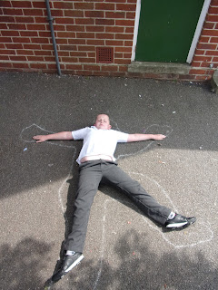 school playground chalk outline boy