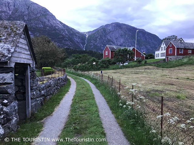 The Eidfjord village in Norway with its red houses at twilight in summer.