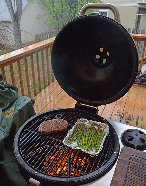 Grilling a thick ribeye steak on a Char-Broil Kamander kamado grill
