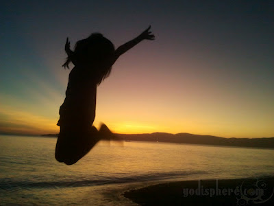 Silhouette of Jumping Girl on Beach