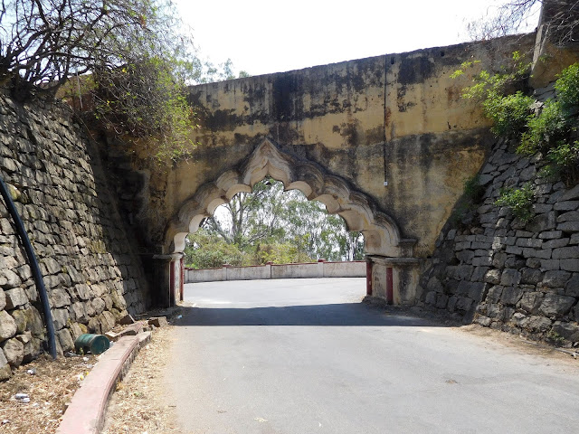 The arched-entrance to the Nandidurg fort, on top of Nandi Hills