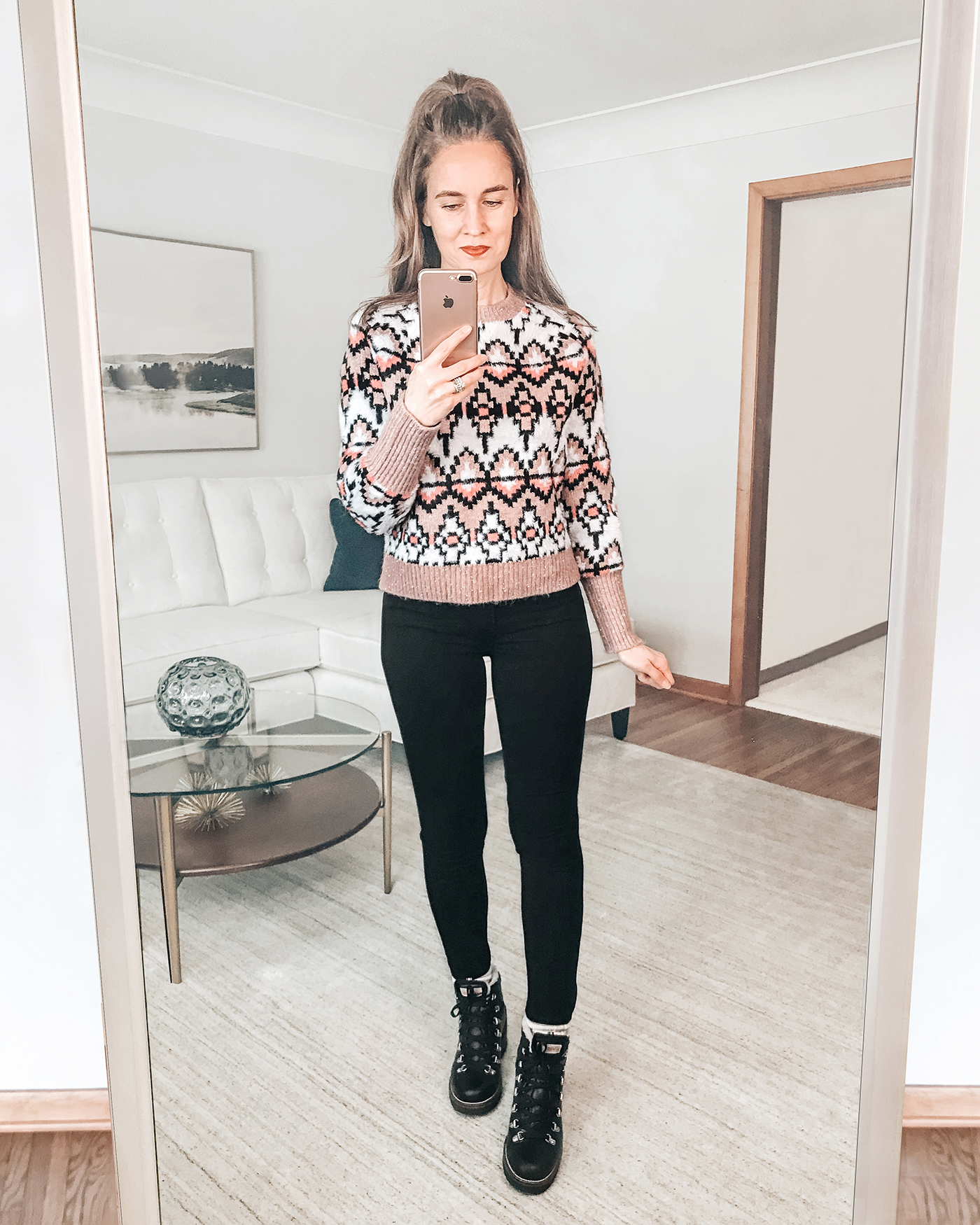 style blogger mirror selfie wearing cozy fair isle winter sweater and lace up hiking boots