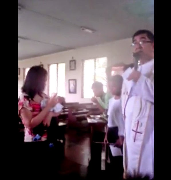 Priest berates unwed mother at her baby's baptism