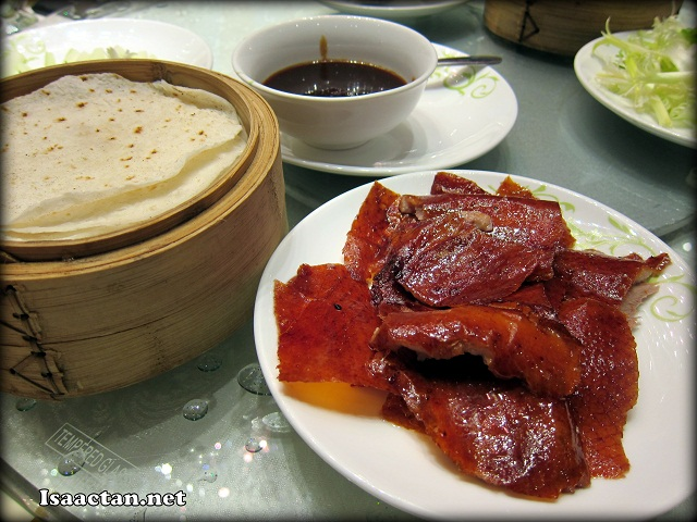"Peking Duck, taken with  ""Momo"", the house-made thin pancakes, scallion, cucumber and specially prepared Hoisin sauce"