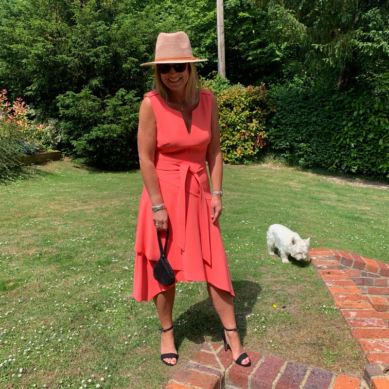 Over 50s fashion blogger Michelle from Fifty and Fab in asymmetric Karen Millen dress