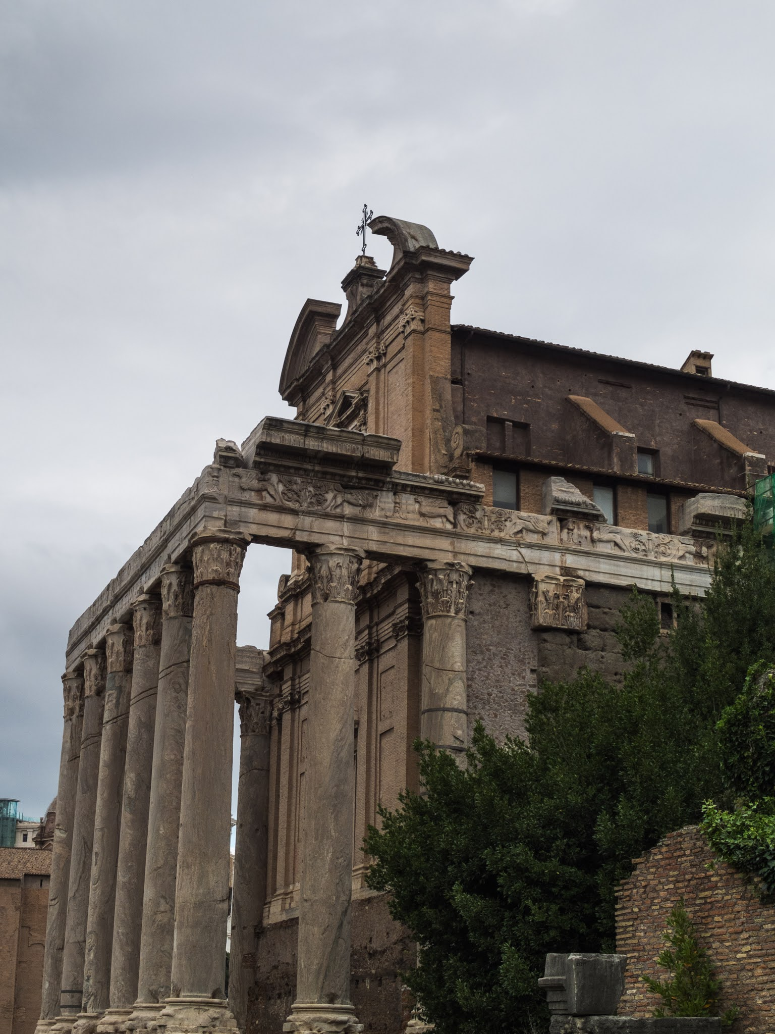 Side view of the temples of Antoninus and Faustina in the Roman Forum.