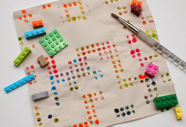 Kid art:  Carefully lift up your newsprint to reveal Lego prints!
