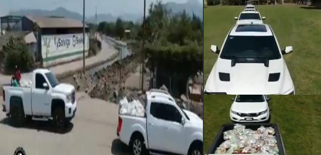 """VIDEO.- Con flotilla de Camionetas de lujo formadas en fila y grabado con drones el CJNG graba sus azañas y """"bondad"""" con el pueblo"""