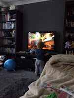 Child in front of the tv watching the movie