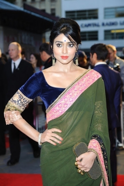 Bollywood Beauty Shriya Saran Hip Photos In White Saree At Movie Premiere Show