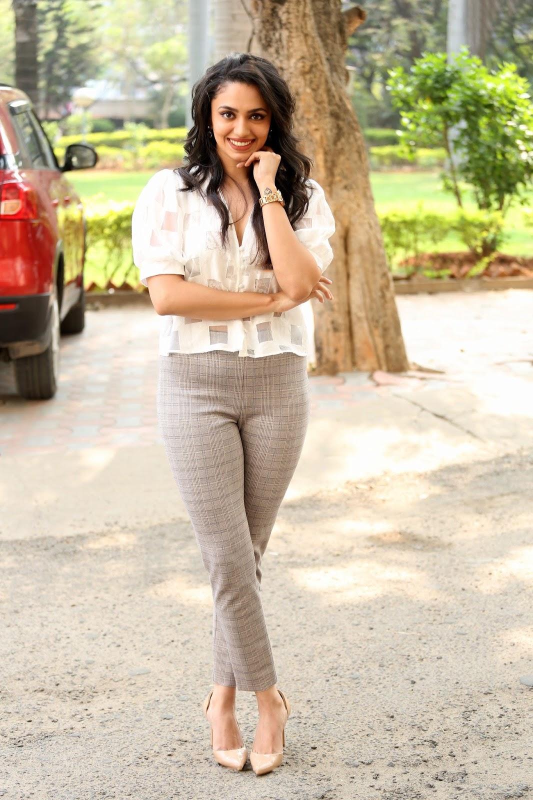 Malavika Nair Dashing In Tight Pant and High Heel at Orey Bujjiga Pre Release