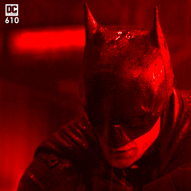 Robert Pattinson as Batman in the rain Text: DC on SCREEN 610