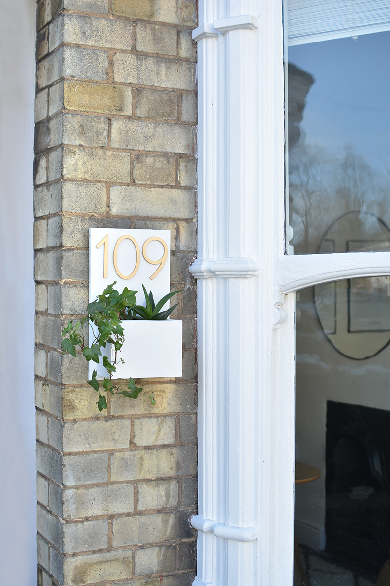 diy house number sign with plants