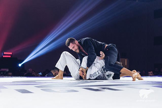 Rafael Lovato Jr. applying a masterful kimura on Gabriel Almeida.