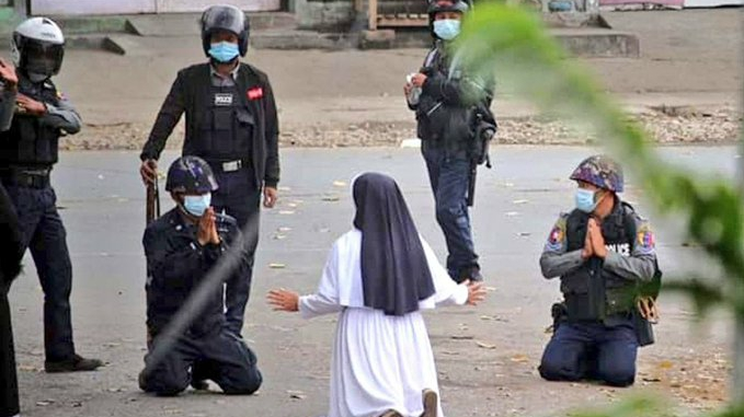 Myanmar: A nun kneels down to rescue protesters