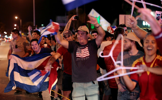 Image Attribute: People celebrate after the announcement of the death of Cuban revolutionary leader Fidel Castro, in the Little Havana district of Miami, Florida, U.S. November 26, 2016. REUTERS/Javier Galeano