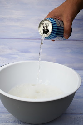 pouring lemonade into cake mix