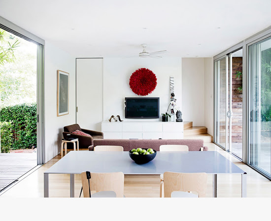 Safari Fusion blog | Colour crush: Red | A stylish Swiss inspired home in Sydney featuring one very beautiful Safari Fusion Red Bamileke Feather Headdress via Homes to Love