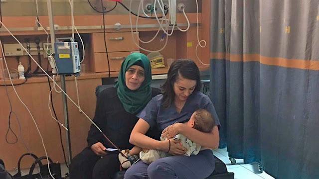 Медсестра еврейка покормила грудью малыша пострадвашей палестинки