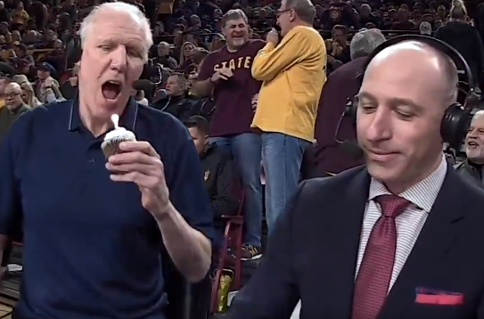 Bill Walton bites into cupcake with lit candle