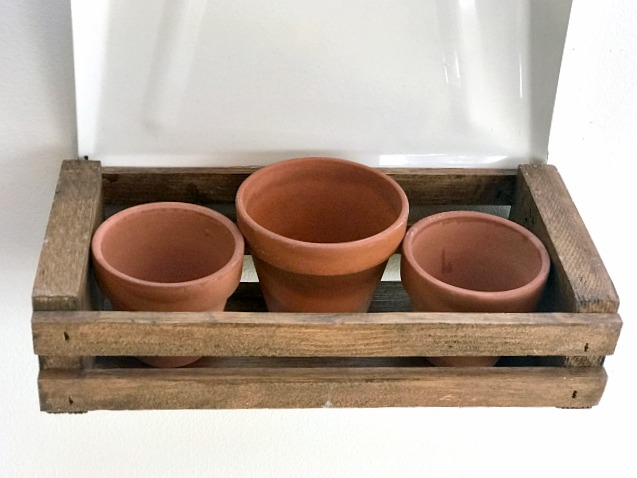 Wooden crate filled with terracotta pots