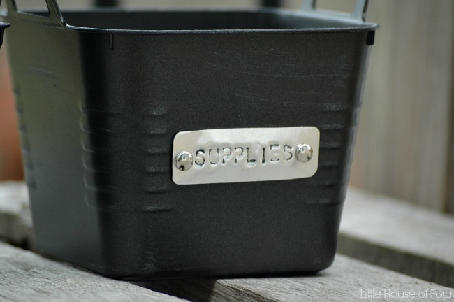 Updated Dollar Tree storage bins with handmade metal tags