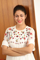 Lavanya Tripathi in Summer Style Spicy Short White Dress at her Interview  Exclusive 226.JPG