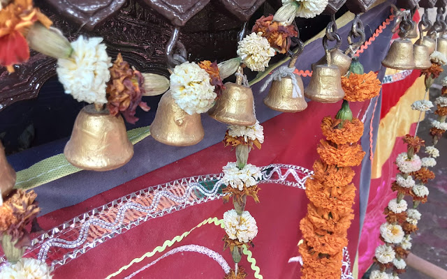 The Decorated Bells of Vimana during Holi Celebration