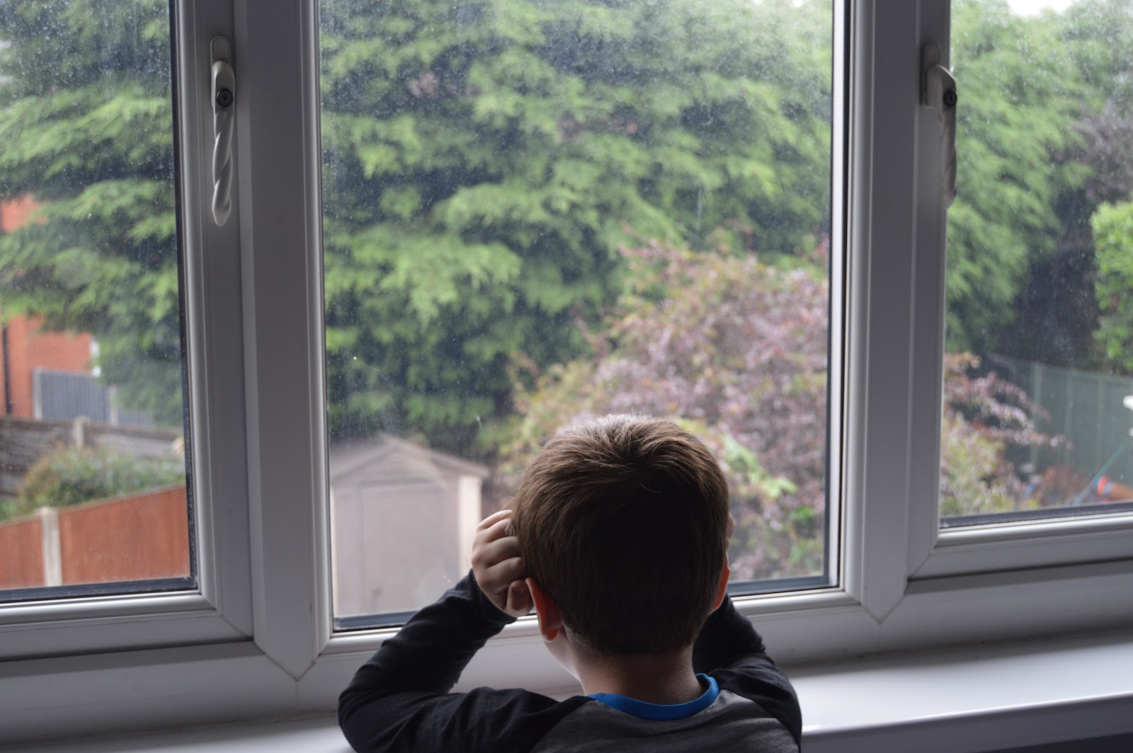 boy looking out of the window