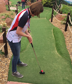 Two-time WMF World Adventure Golf Masters women's champion Emily tees-off the minigolf event at Bents Garden and Home
