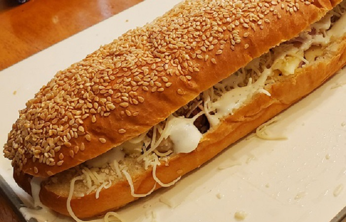 this is a full stuffed french bread with chicken cordon bleu