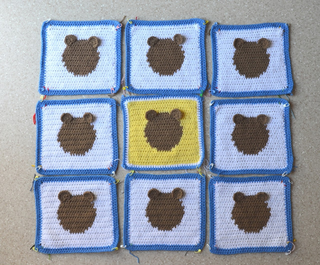 An above-view of the nine squares laid out flat with two ears stitched to the tops of each circle. The 'faces' remain 'blank' with no detail as yet.