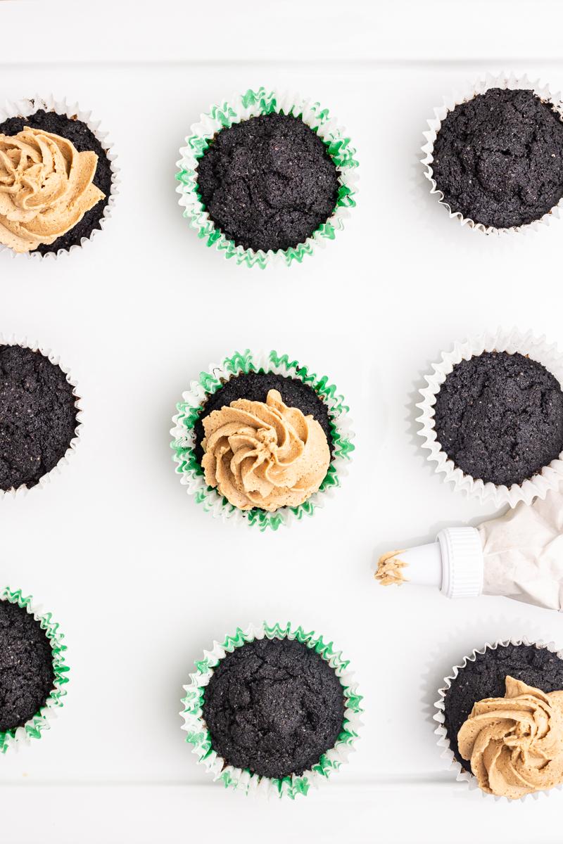 Overhead photo of frosting Keto Irish Coffee Cupcakes.