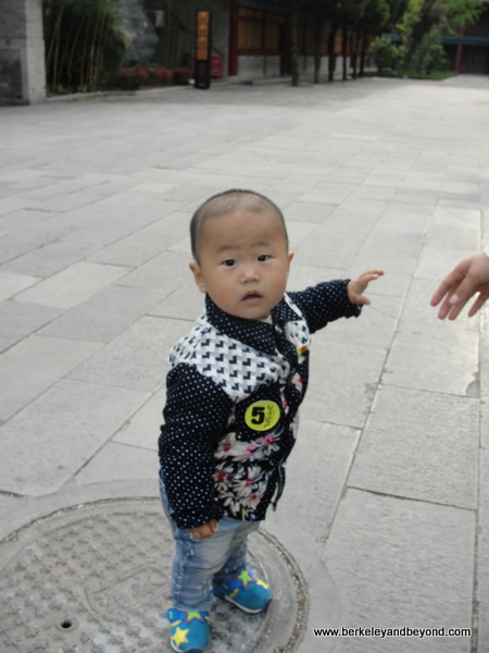 toddler visiting Big Wild Goose Pagoda in Xi'an, China