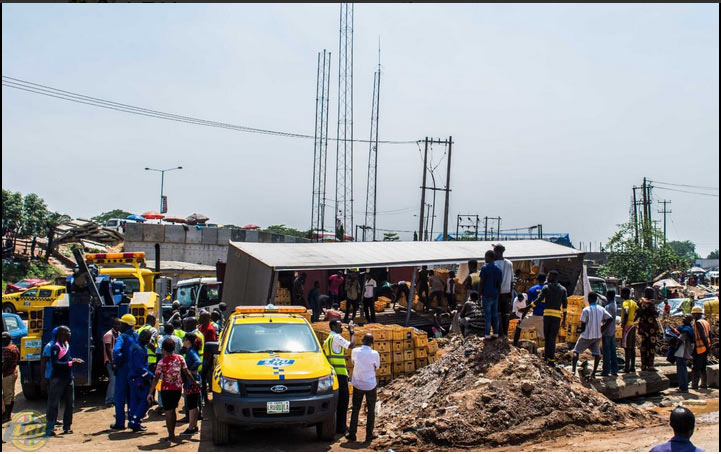 Truck overloaded with alcoholic drinks falls in Lagos