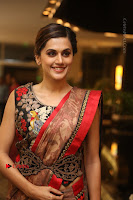 Tapsee Pannu Latest Stills in Red Silk Saree at Anando hma Pre Release Event .COM 0055.JPG